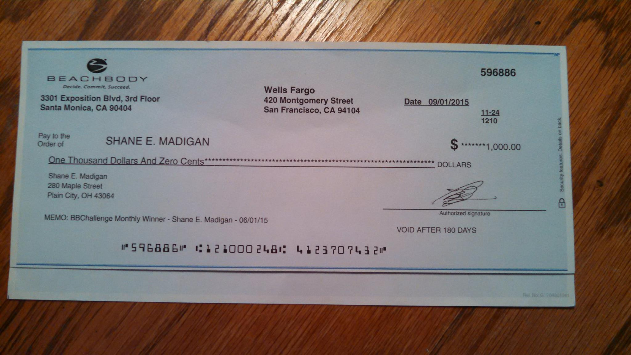 Shane Won $1,000 Through The Beachbody Challenge Endorse A Check